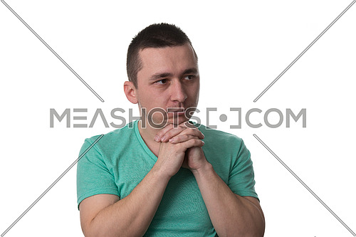 Portrait Of The Young Thinking Man Looks Up With Hand Near Face - Isolated On White Background