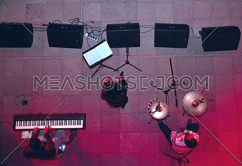 a stage top view of a band performing LIVE