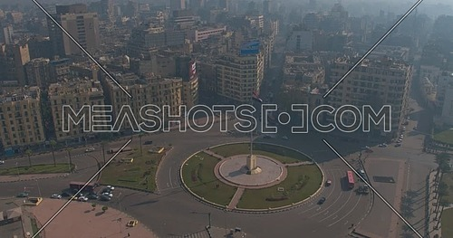 Drone Shot for Tahrir Square in Downtown in Cairo at daytime Flying towards the flag pole