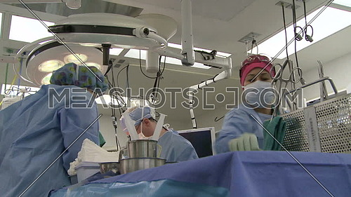 Low shot of surgical assistants during surgery