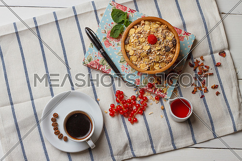 Breakfast setting with a cup of coffee and bowl of cereals