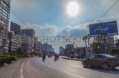 fixed shot for traffic in Gamet Al Dowal Street at Cairo at Day
