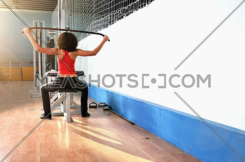 young woman practicing fitness and working out in a gym