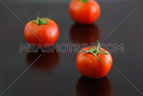 Tomatos put on a black table top