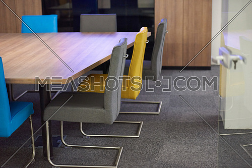 meeting office room with white modern table and orange chairs with glass wall