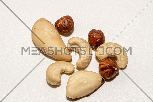 Mixed of nuts isolated on white background.  Cashews, hazelnuts and brazil nut