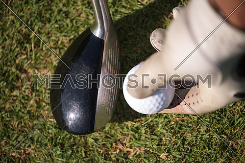 golf club and ball in grass on course preparing for shot