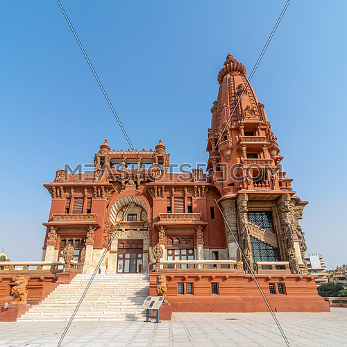 Low angle view of front facade of Baron Empain Palace, a historic mansion inspired by the Cambodian Hindu temple of Angkor Wat, located in Heliopolis district, Cairo, Egypt