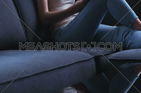 woman using technology on sofa in modern apartment