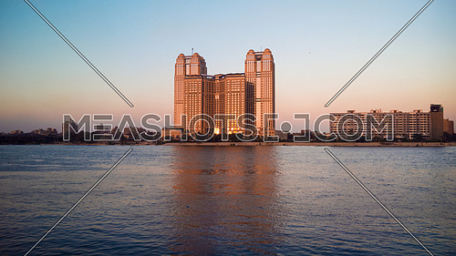 Nile City towers in cairo egypt at sunset.