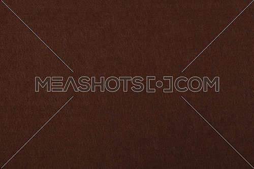Dark brown felt textile material background texture close up
