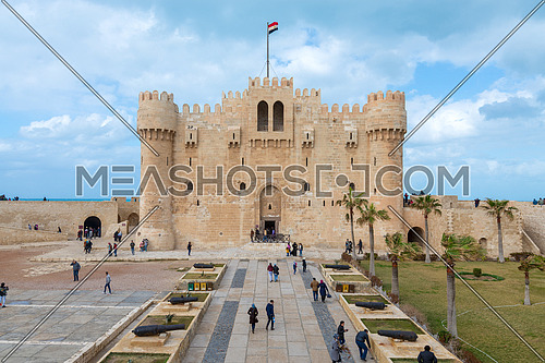 Alexandria, Egypt - January 25, 2018: Citadel of Qaitbay, a 15th century defensive fortress located on the Mediterranean sea coast, established in 1477 AD with local residents visiting the place
