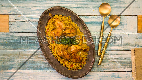 a traditional gulf dish Mashboos chicken with rise on a table top
