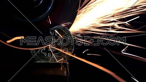 Electric wheel grinding on Bitcoin on black background