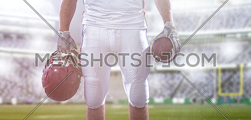 Closeup Portrait of a strong muscular American Football Player on big modern stadium field with lights and flares