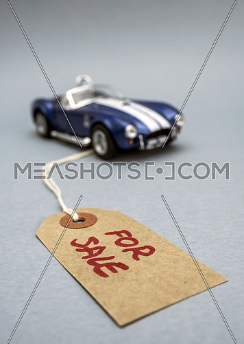 Miniature car. Vintage label with written word for sale, market concept