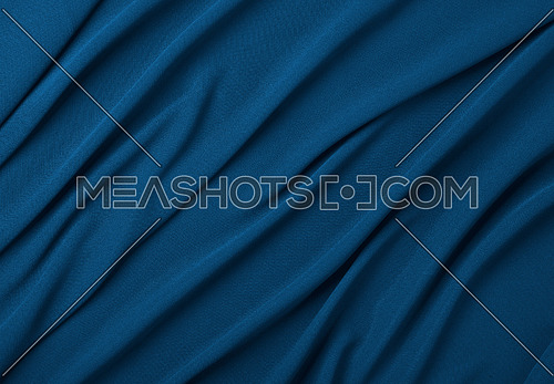 Close up abstract textile background of dark navy blue folded pleats of fabric, elevated top view, directly above