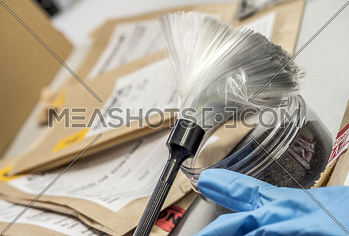 Police record along with some forensic evidence of murder at Laboratorio forensic equipment, conceptual image