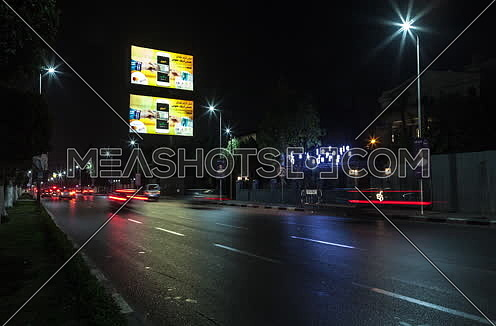 Zoom OUT Shot for traffic at Salah Salim Street at Night
