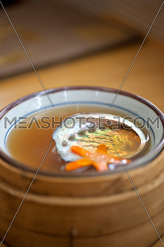Japanese style abalone soup empty shell  on bamboo bowl set holder