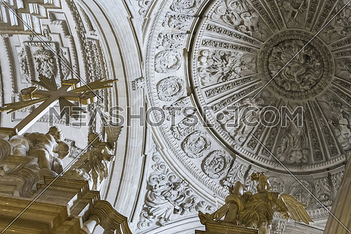 Jaen, Spain - may 2016, 2: Detail of dome with four Evangelists in their pendentives and is decorated with eight figures of angels-musicians, vault center of the main nave that covers the choir in the Cathedral of Jaen, take in Jaen, Spain