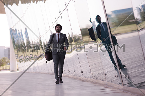 handsome middle eastern business man walking