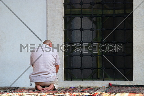 a man in a mosque praying