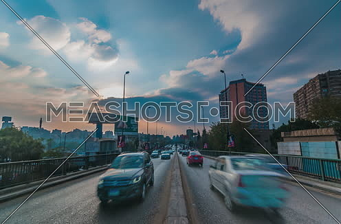 fixed shot for traffic in 15th of July Bridge at Cairo at Day