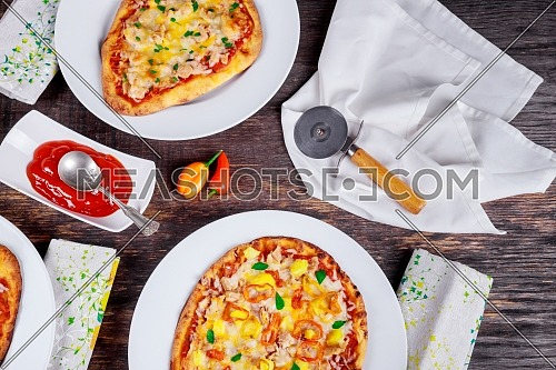 Italian Pizza Dinner Restaurant Menu - Margarita and Salmon pizzas served on wooden table Top View