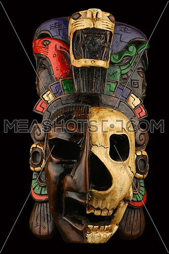 Mexican Mayan Aztec ceramic painted mask with skull isolated on black