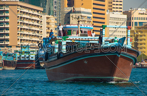 merchant ship sailing in the dubai creek