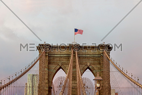 Brooklyn Bridge in New York American flag - star and stripes floating