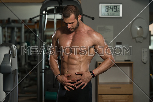 Portrait Of A Physically Fit Man Showing His Well Trained Body