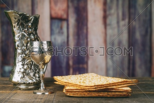 Glass of Passover wine and jewish matzah bread