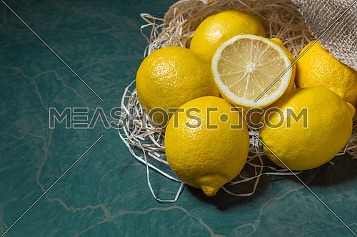 Fresh lemons stacked on jute sack