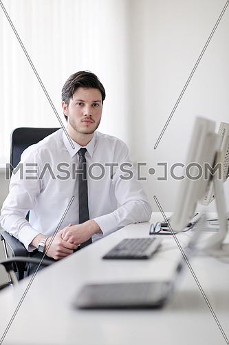 Portrait of a handsome young business man  at office meeting