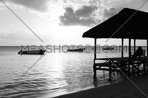 Resting on remote Paradise beach,Mauritius island.black and white.