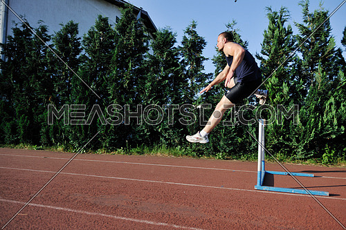 young healthy man run on athletic race sport track and representing concept of sort and speed