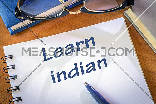 Learn indian written in a notepad. Education concept