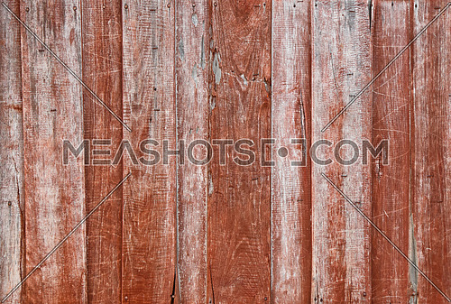 Close up background texture of brown red vintage painted weathered wooden planks, rustic style wall or fence
