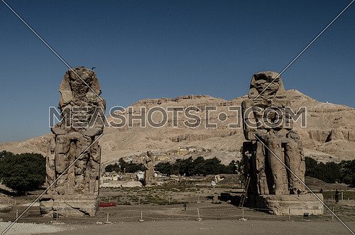 The famous two statues of Colossi of Memnon in Luxor - Egypt