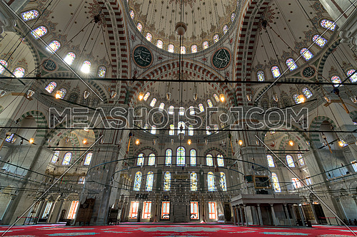 Fatih Mosque, a public Ottoman mosque in the Fatih district of Istanbul, Turkey, with a huge arches, decorated domes and colored stained glass windows