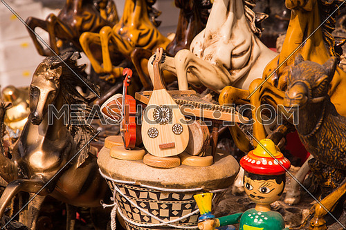 Wooden props randomly put together consists of  music instruments and wooden horses