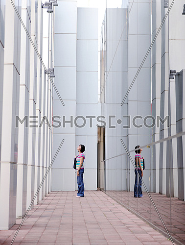 Beautiful woman  outdoor modern city urban street scene with abstract  glass reflections