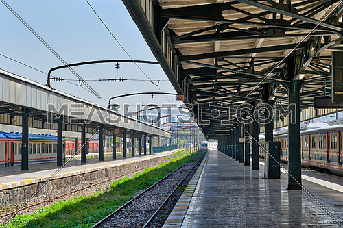 Interior shot of Haydarpasha Railway Terminal featuring metal truss and two colored stopped trains, Kadikoy, Istanbul, Turkey, built 1909 and closed in 2013 due to the rehabilitation of Marmaray line