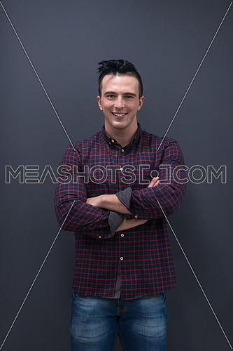 portrait of young business man in casual clothes grey wall in background