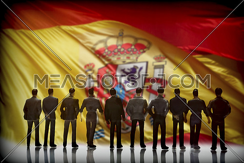 Silhouette of several men in front of the Spanish flag, conceptual image