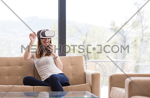 Smile happy woman getting experience using VR-headset glasses of virtual reality at home
