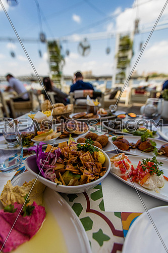 middle eastern food on a table in an outdoor restaurant