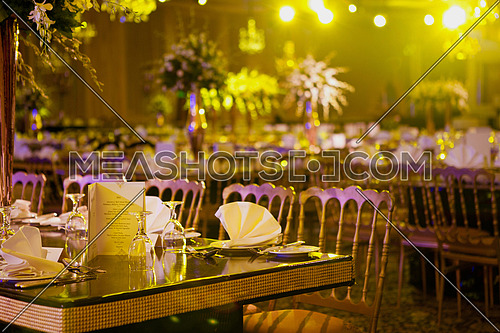 Wedding Tables Setup with Flower, cloth napkins and glasses in hotel
